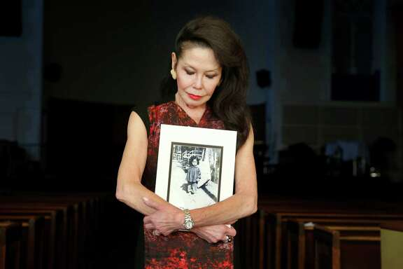 Janice Mirikitani holds a photograph of herself as a young girl living in the internment camp in Arkansas. Janice Mirikitani, former San Francisco poet laureate and founder of the Glide Foundation, is against the auctioning off of historical artifacts and artwork from the Japanese internment camps.  Mirikitani was held in one of those camps as a young girl in Arkansas.