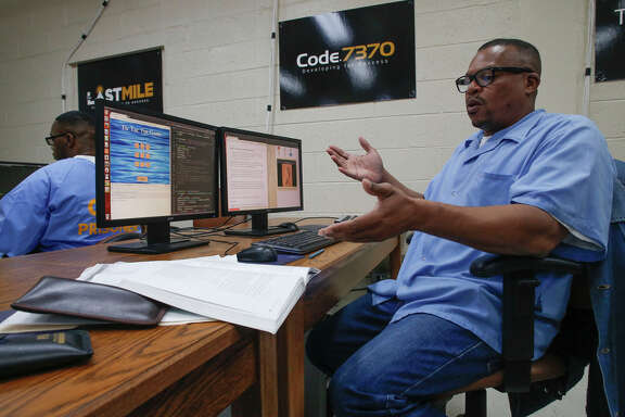 Inmate Aly Tamboura writes computer code to complete an assignment as San Quentin State Prison inmates take advantage of the computer coding class.