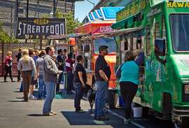 People wait for their food during lunch time at the Streat Food Park in San Francisco, Calif., is seen on Thursday, June 28th, 2012.