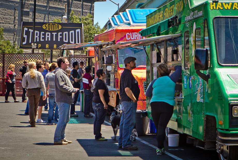 People wait for their food during lunch time at the Streat Food Park in San Francisco, Calif., is seen on Thursday, June 28th, 2012. Photo: John Storey, Special To The Chronicle