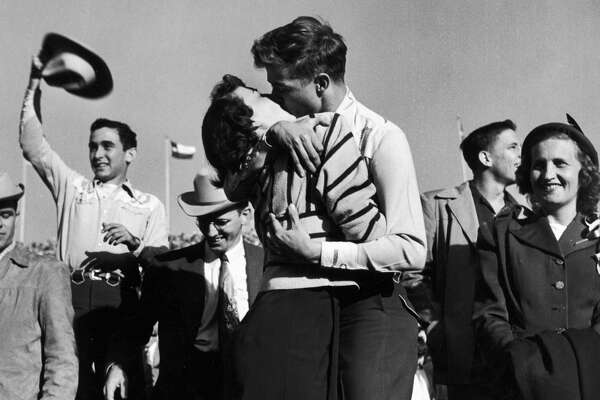 Pair of Texas University students kissing after a close football victory over Southern Methodist University, who had been the favored team, in November 1950.