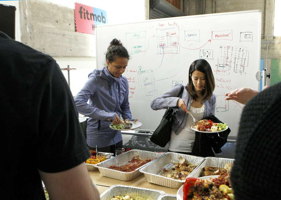 Kim Pham (right) grabs lunch with the Fitmob staff, Wednesday, April 15, 2015, in San Francisco, Calif. Pham is visiting Fitmob through Lunchcruit, a recruiting company that has potential prospects lunch at the place they're considered. Photo: Santiago Mejia, The Chronicle