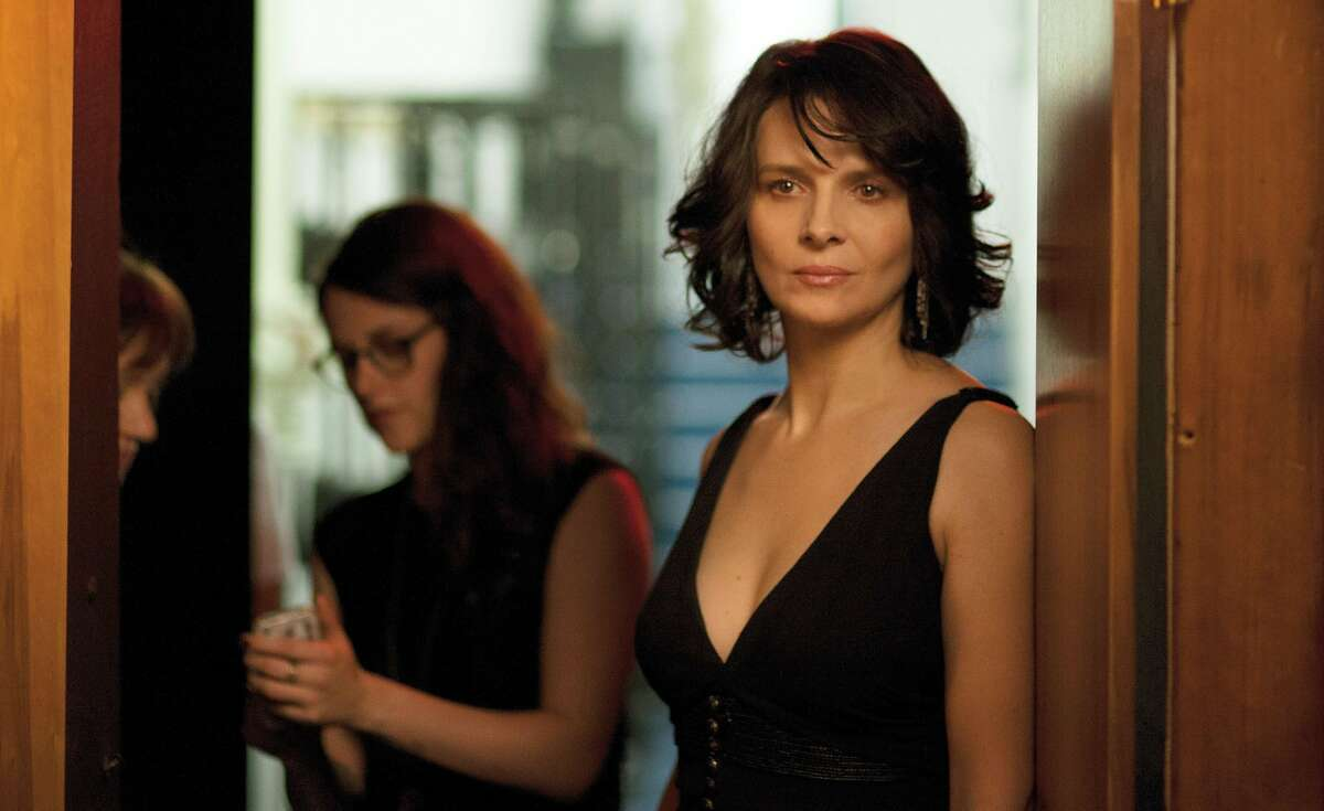 This image released by IFC Films shows Kristen Stewart, left, and Juliette Binoche in a scene from