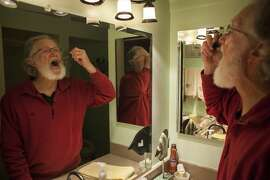 Doug Stiles ingests 20 drops of liquid Marijuana in his home at a retirement community called Rossmoor in Walnut Creeks on April 14th 2015. Stiles takes the drops before bed to help with his anxiety and to help him sleep.