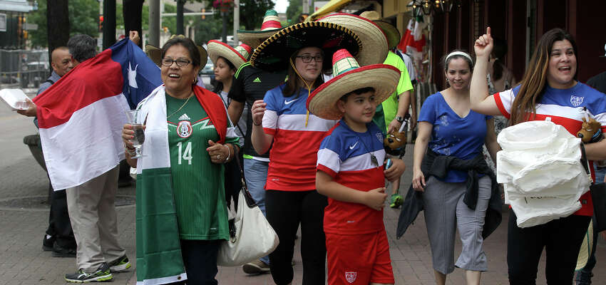 Soccer fans walk in Alamo Plaza Wednesday April 15, 2015 in anticipation of the match between the United States and Mexico's men's national soccer teams to be held at the Alamodome.