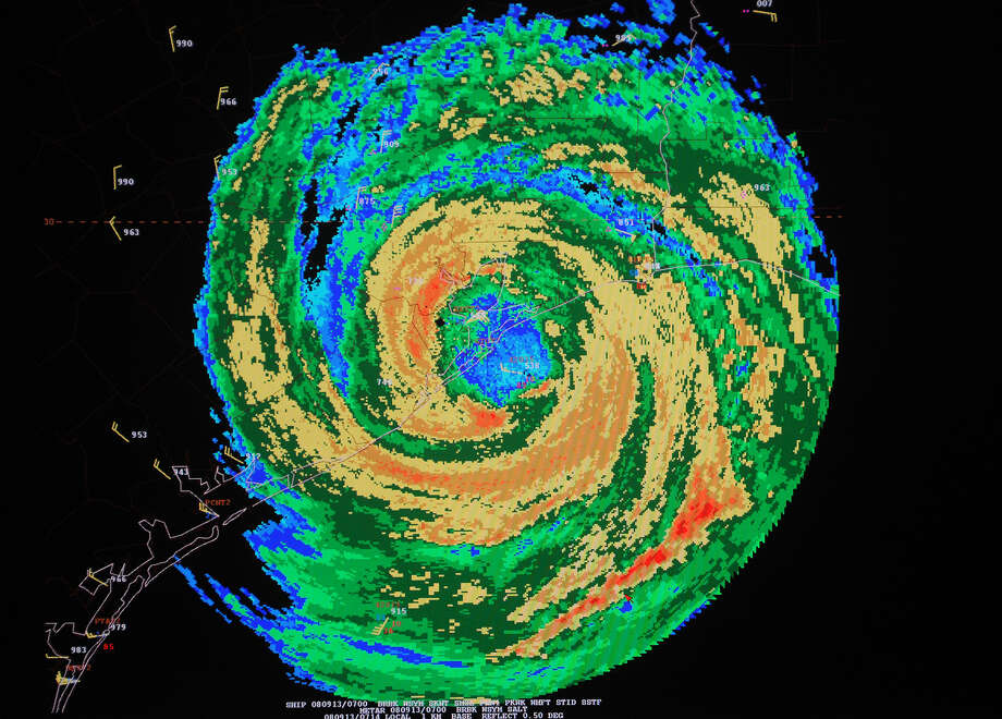 A video monitor, at the National Hurricane Center in Miami, shows an enhanced radar image of Hurricane Ike as it comes ashore on Galveston, Texas, at about 3:10 a.m. ET Saturday, Sept. 13, 2008. According to forecasters, Ike arrived as a strong Category 2 storm with maximum sustained winds of about 110 mph. Photo: Andy Newman, AP Photo/Andy Newman / Associated Press