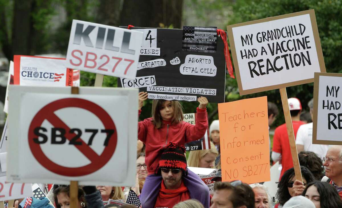 In this April 8, 2015 file photo, protesters rally against a measure requiring California schoolchildren to get vaccinated at the Capitol in Sacramento, Calif. Senate Bill 277, a California bill that would sharply limit vaccination waivers after a Disneyland measles outbreak, has generated such an acidic debate that Sen. Richard Pan, the proposal's author, was under added security this week. (AP Photo/Rich Pedroncelli, file)