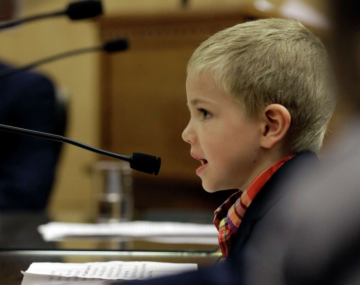 Rhett Krawitt, 7, of Corte Madera, who could not be vaccinated while he was being treated for leukemia, speaks to lawmakers.