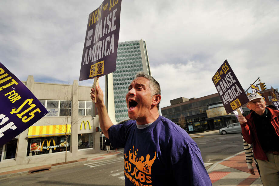 A building maintenance worker Jackon Ojedis, a member of SEIU local 32BJ, chants during a rally in support of underpaid service workers in front of the Ferguson Library in Stamford, Conn., on Wednesday, April 15, 2015. The event was organized by SEIU local 32BJ attended by the union members and other low-wage workers. The protest was in conjunction with other rallies in over 230 cities and college campuses world-wide. Photo: Jason Rearick / Stamford Advocate