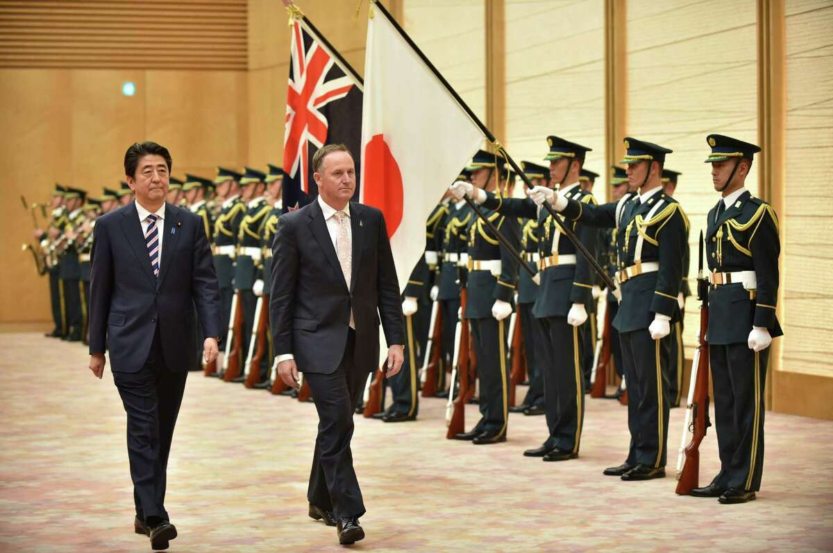 New Zealand Prime Minister John Key (right) and Japan Prime Minister Shinzo Abe discussed the Trans-Pacific Partnership free trade negotiations during a meeting last month in Tokyo.