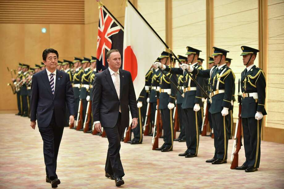 New Zealand Prime Minister John Key (right) and Japan Prime Minister Shinzo Abe discussed the Trans-Pacific Partnership free trade negotiations during a meeting last month in Tokyo. Photo: Kazuhiro Nogi / Associated Press / AFP POOL