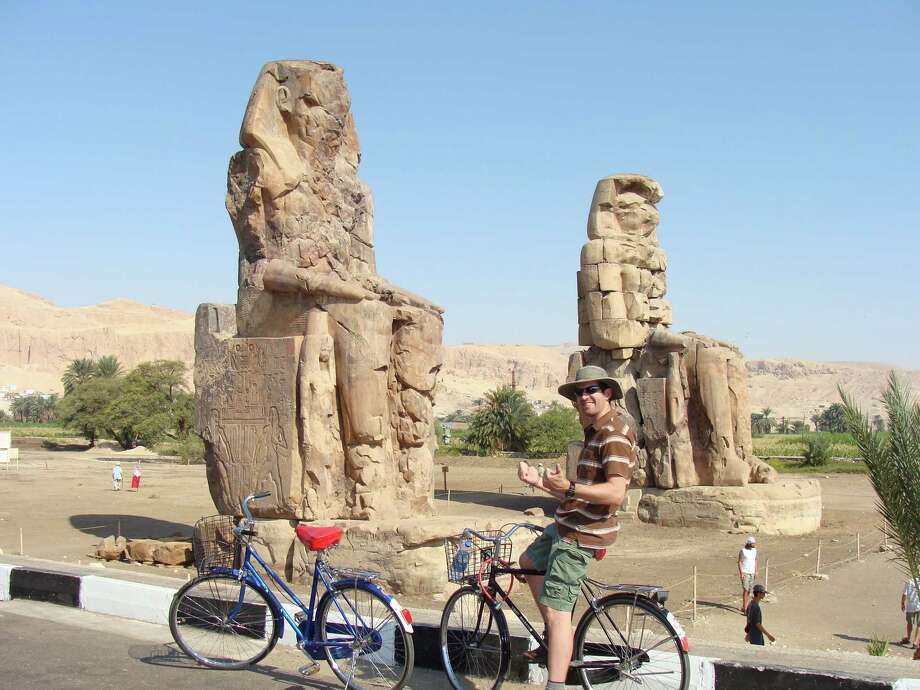 Stopping for a break next to the Colossi of Memnon in Egypt. Photo: Pickett Porterfield / Courtesy Photo / PICKETT PORTERFIELD