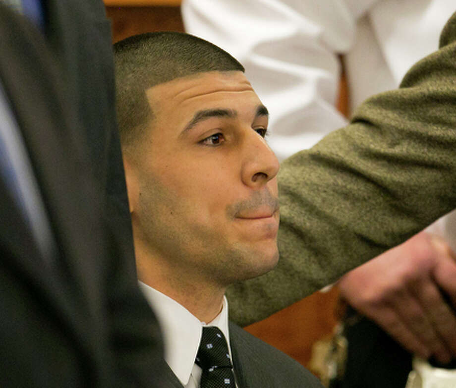Aaron Hernandez listens as the guilty verdict is read during his murder trial. Photo: Dominick Reuter / Associated Press / Pool Reuters