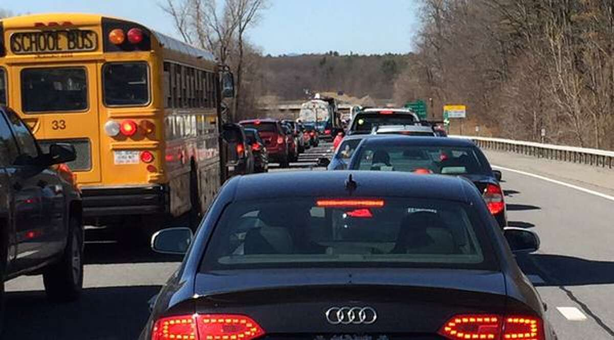 Traffic is backed up on 87 northbound Wednesday, April 15, 2015, after a tractor trailer fiire sparked a brush fire. (Skip Dickstein/Times Union)