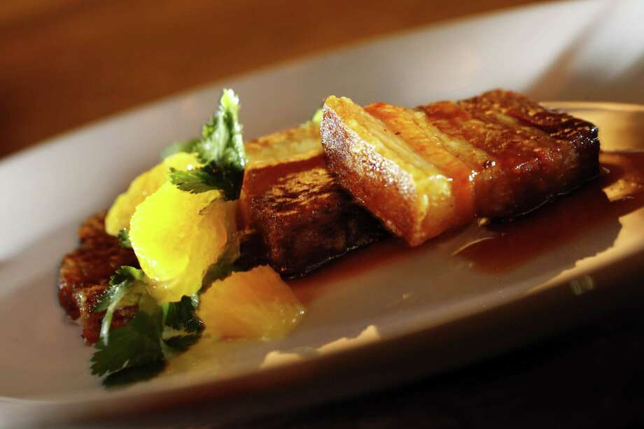 The Pork Belly Confit served at Trou Normand, the new restaurant from the Bar Agricole folks, in San Francisco, Calif., on Monday, March 17, 2014. Photo: Carlos Avila Gonzalez / The Chronicle / ONLINE_YES