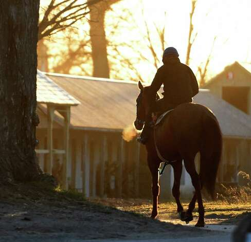 Tom's Vision with exercise rider Nial Goodwin aboard heads  to the Oklahoma Training Track on opening day Wednesday April 15, 2015 in Saratoga Springs, N.Y.      (Skip Dickstein/Times Union) Photo: SKIP DICKSTEIN / 00031454A