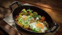 Duck confit hash with baked eggs at Cotogna in San Francisco.