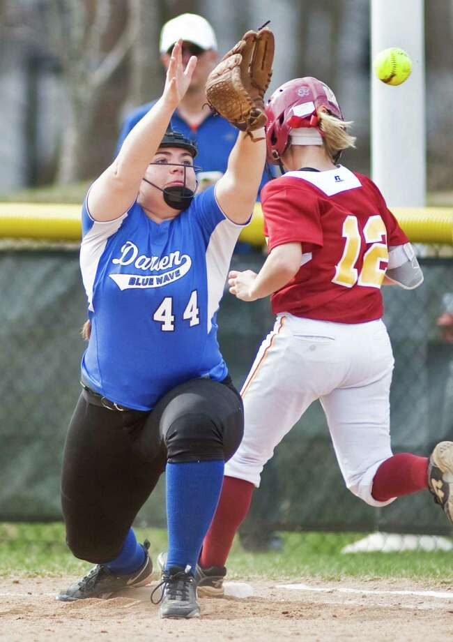 Darien High School's Sophia Barbour tries to get the out at 1st in a game against St. Joseph High School, played at Darien. Wednesday, April 15, 2015 Photo: Scott Mullin / The News-Times Freelance