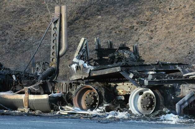 Emergency crews work the scene of a truck fire that shut down the I-87 north bound between exits 10 and 11 during rush hour on Wednesday April 15, 2015 in Malta, N.Y. (Michael P. Farrell/Times Union) Photo: Michael P. Farrell / 00031470A