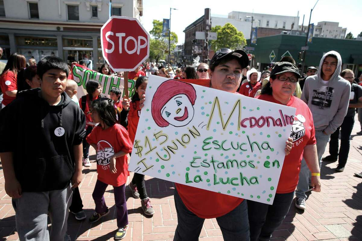 Taco Bell worker Veronica Gonzales joins fellow fast food workers and supporters during a rally for a higher minimum wage near Sproul Plaza on the UC Berkeley campus in Berkeley, Calif., on Wed. April 15, 2015.