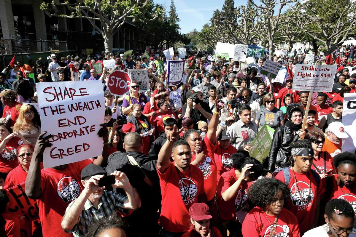 Hundreds of fast food workers and supporters rally for a higher minimum wage near Sproul Plaza on the UC Berkeley campus in Berkeley, Calif., on Wed. April 15, 2015.
