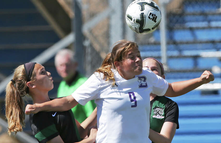 Greyhounds forward Paige Marcell (9) keeps Wildcats players Daphne Hunt (;eft) and Cara Hunt away from the ball as Boerne loses to Kennedale 4-3 in the Class 4A state girls soccer semifinals at Birkelbach Field in Georgetown on April 15, 2015. Photo: Tom Reel /San Antonio Express-News