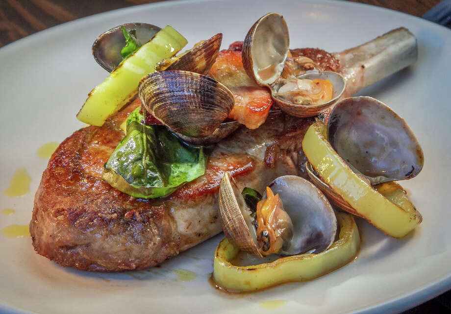 Pork chop with Manila clams, gypsy peppers and new potatoes at Molina. Photo: John Storey / Special To The Chronicle / ONLINE_YES