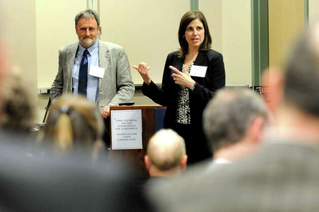Danielle Merfeld, global technology director of Electrical Technologies and Systems at General Electric, right, speaks during the Northeast Semi Supply Conference on Wednesday, April 15, 2015, at SUNY Polytechnic Institute in Albany, N.Y. Joining her is Michael Liehr, executive vice president of Innovation and Technology at SUNY Polytechnic Institute. (Cindy Schultz / Times Union) Photo: Cindy Schultz / 00031442A