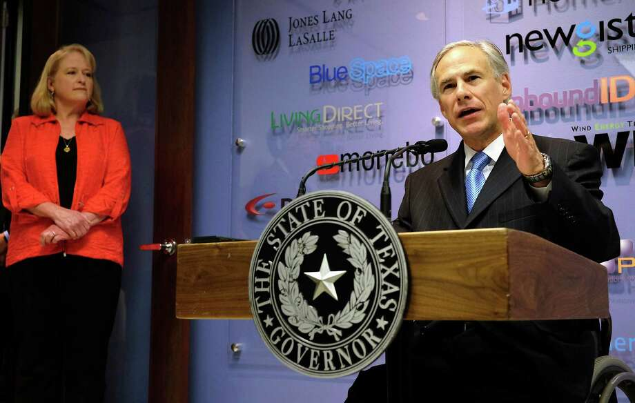 Texas Gov. Greg Abbott discusses plans to reduce business franchise taxes as Ellen Wood, left, President and CEO of VCFO, looks on during a news conference Wednesday, April 15, 2015, in Austin, Texas. (Rodolfo Gonzalez/Austin American-Statesman via AP) Photo: Rodolfo Gonzalez, MBO / Associated Press / Austin American-Statesman