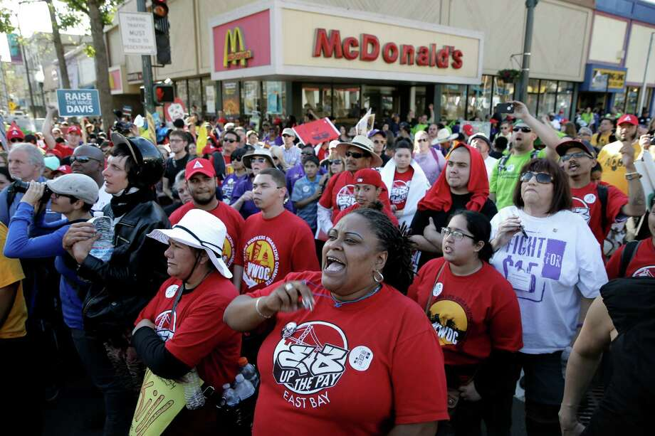 Fast food workers and their supporters march in Berkeley on April 15, 2015, protesting for a higher minimum wage. The issue highlights how the gap between the very rich and everyone else is especially stark in the Bay Area. Photo: Michael Macor / The Chronicle / ONLINE_YES