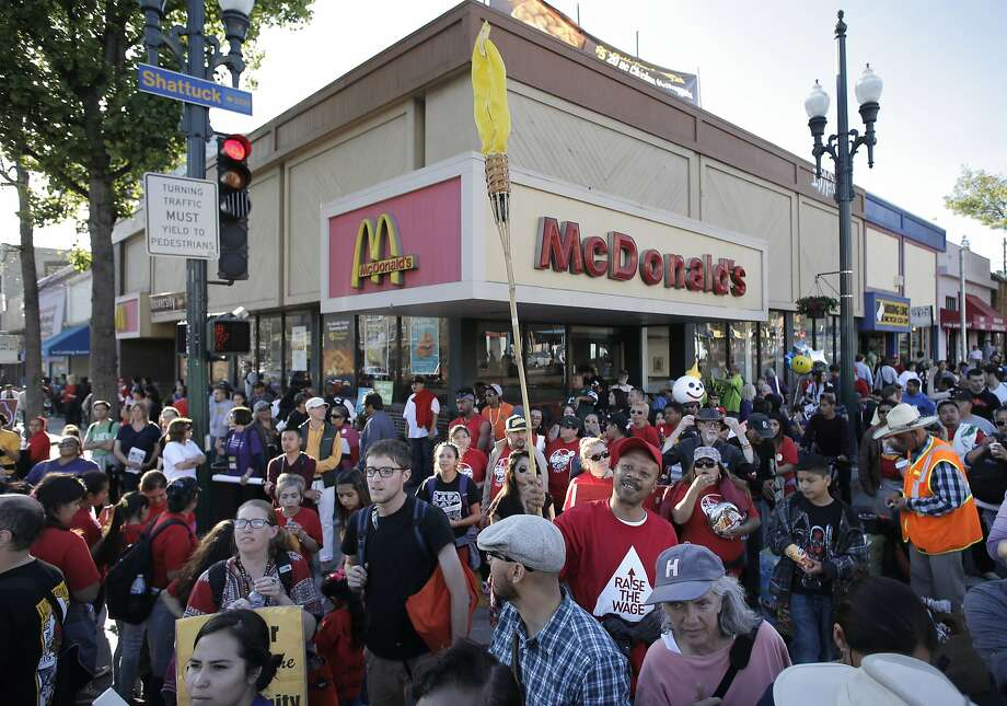 Thousands of fast food workers and their supporters marched to the McDonald's on the corner of University and Shattuck Ave's in Berkeley, Calif., on Wed. April 15, 2015, protesting for a higher minimum wage. The Mcdonald's restaurant had closed up their business hours before protesters arrived. Photo: Michael Macor, The Chronicle