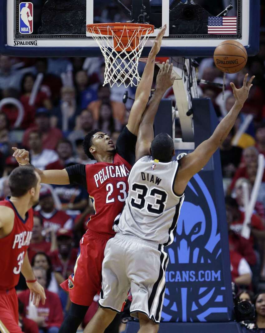 Antonio Spurs center Boris Diaw (33) goes to the basket against New Orleans Pelicans forward Anthony Davis (23) in the first half of an NBA basketball game in New Orleans, Wednesday, April 15, 2015. (AP Photo/Gerald Herbert)San
