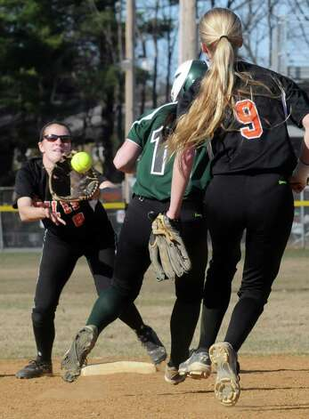 Shen's Kelly O'Gorman is caught in a run down by Bethlehem's Brooke Corbett, left, and Emma Downing during their girl's high school softball on Wednesday April 15, 2015 in Clifton Park, N.Y. (Michael P. Farrell/Times Union) Photo: Michael P. Farrell / 00031408A