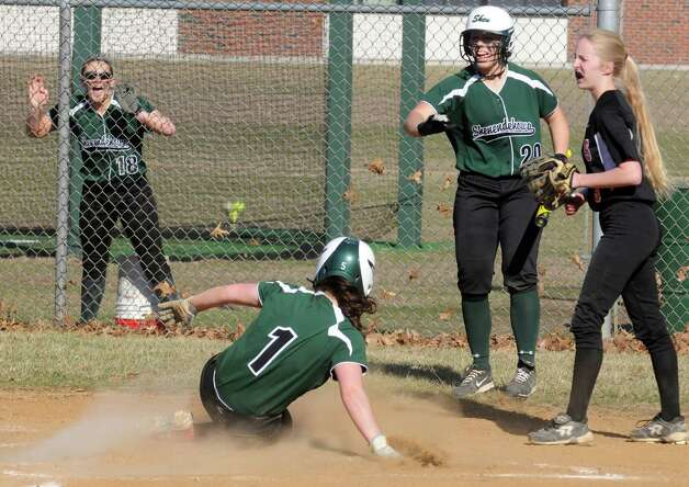 Shen's Marissa Kirker crosses the plate for a run during their girl's high school softball game against Bethlehem on Wednesday April 15, 2015 in Clifton Park, N.Y. (Michael P. Farrell/Times Union) Photo: Michael P. Farrell / 00031408A