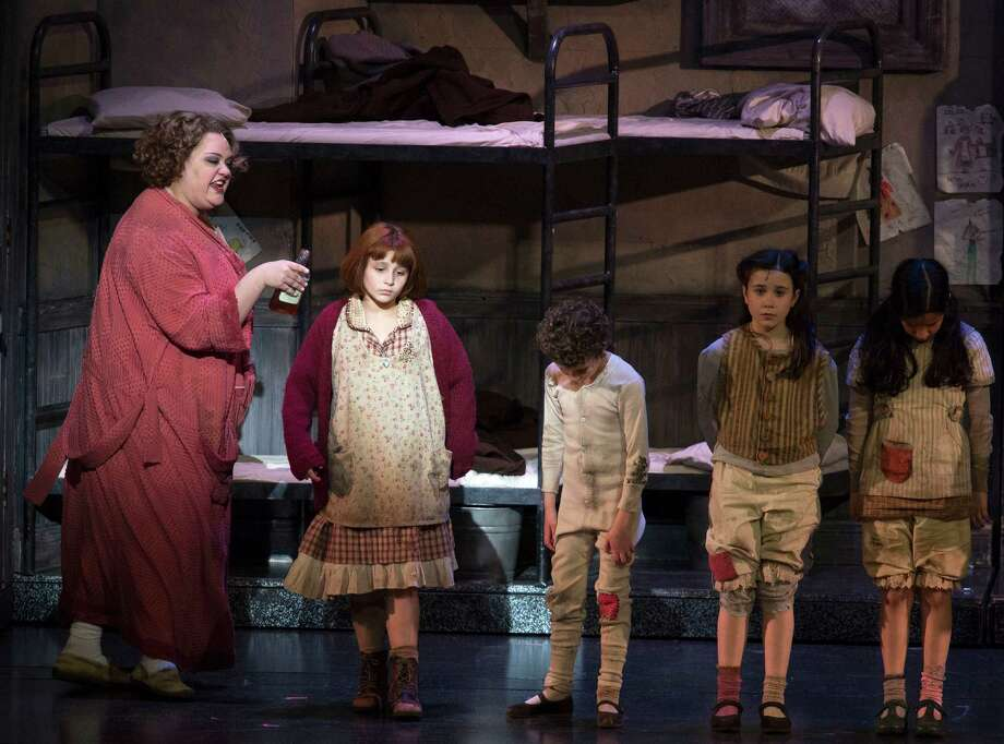 "Players perform in the musical, ""Annie,"" Tuesday, April 14, 2015, at the Majestic Theatre in San Antonio. (Darren Abate/For the Express-News) Photo: Darren Abate, FRE / Darren Abate/Express-News"