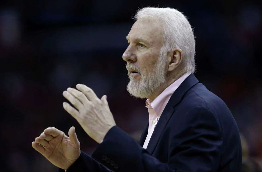 San Antonio Spurs head coach Gregg Popovich calls out rom the bench in the first half of an NBA basketball game against the New Orleans Pelicans in New Orleans, Wednesday, April 15, 2015. Photo: Gerald Herbert, AP / AP