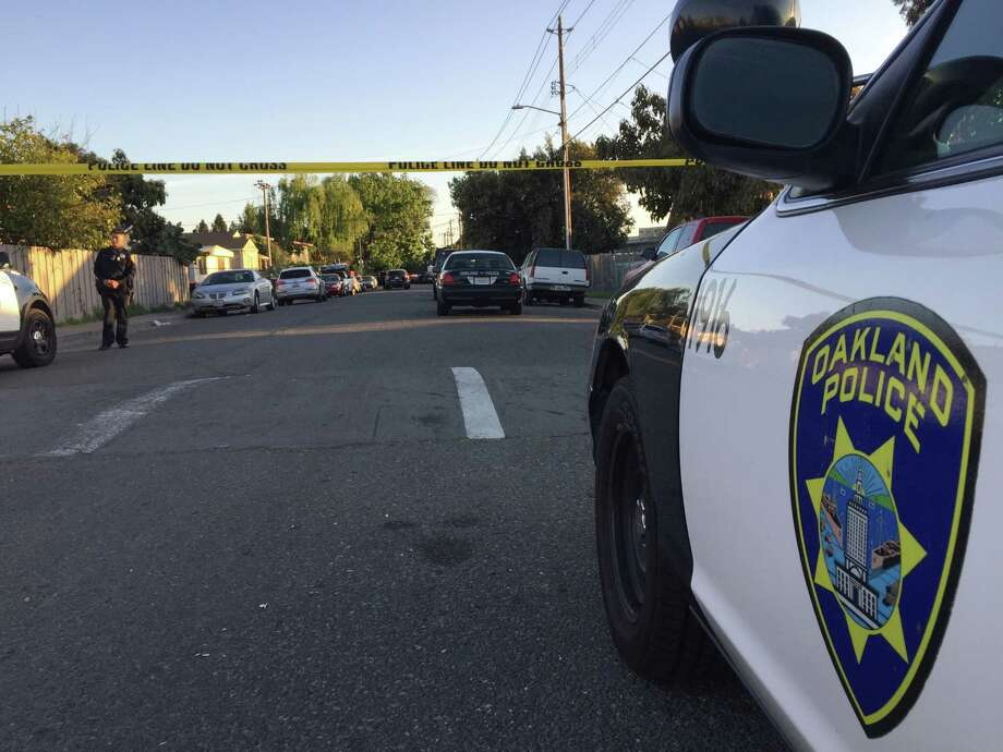 Police cordoned off 105th Avenue in Oakland after a San Leandro Police Officer shot a woman who allegedly rammed a police vehicle with a car that was reported stolen in Oakland earlier in the day. Photo: Kale Williams / The Chronicle / ONLINE_YES