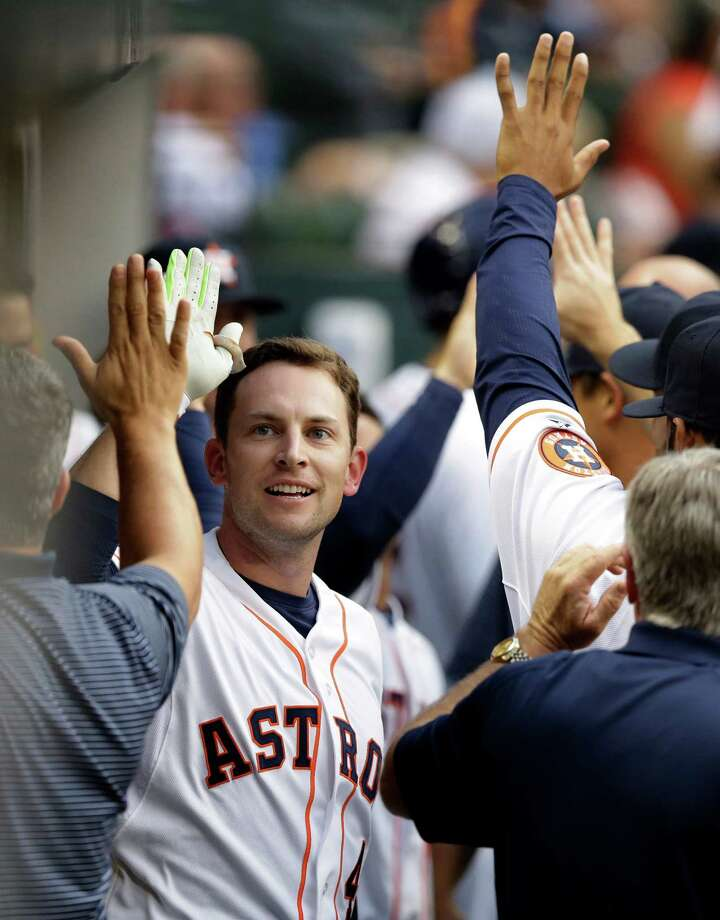Houston Astros' Jed Lowrie is congratulated after hitting a two-run home run against the Oakland Athletics during the first inning of a baseball game Wednesday, April 15, 2015, in Houston. (AP Photo/Pat Sullivan) Photo: Pat Sullivan / Associated Press / AP