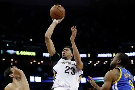 Anthony Davis (center) carries New Orleans' hopes of a first-round surprise.