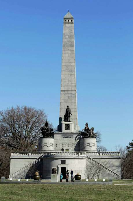 Visitors stand outside Abraham Lincoln's tomb within the Oak Ridge Cemetery in Springfield, Ill. National Geographic recently scored the site. Photo: Seth Perlman /Associated Press / AP
