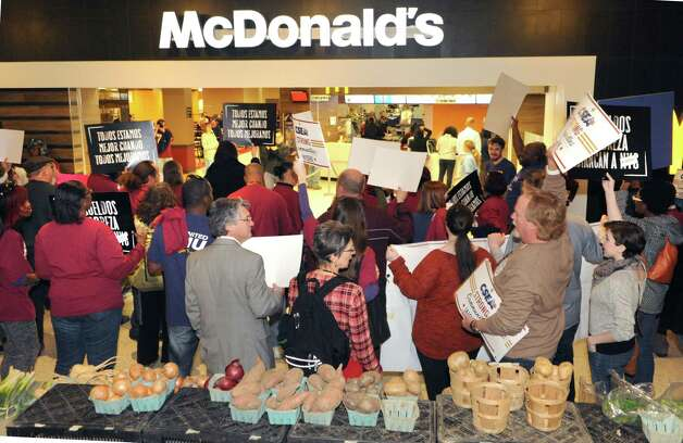 Fast food workers and others march across the concourse and stand in front of McDonald's in support of a $15 per hour minimum wage at the Empire State Plaza on Wednesday, April 15, 2015 in Albany, N.Y. (Lori Van Buren / Times Union) Photo: Lori Van Buren / 00031444A