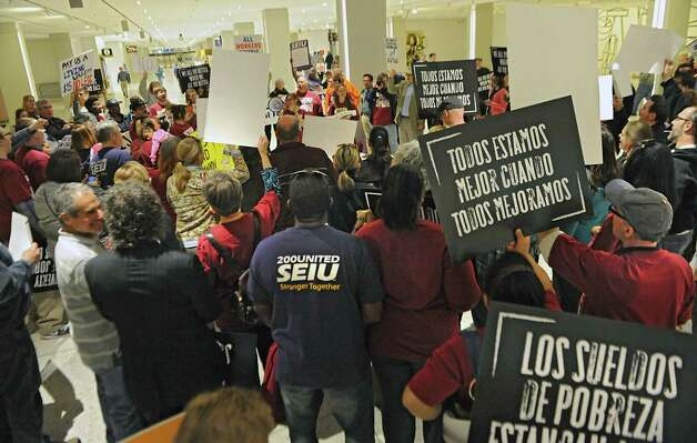 Fast food workers and others rally in support of a $15 per hour minimum wage at the Empire State Plaza on Wednesday, April 15, 2015 in Albany, N.Y. (Lori Van Buren / Times Union) Photo: Lori Van Buren / 00031444A