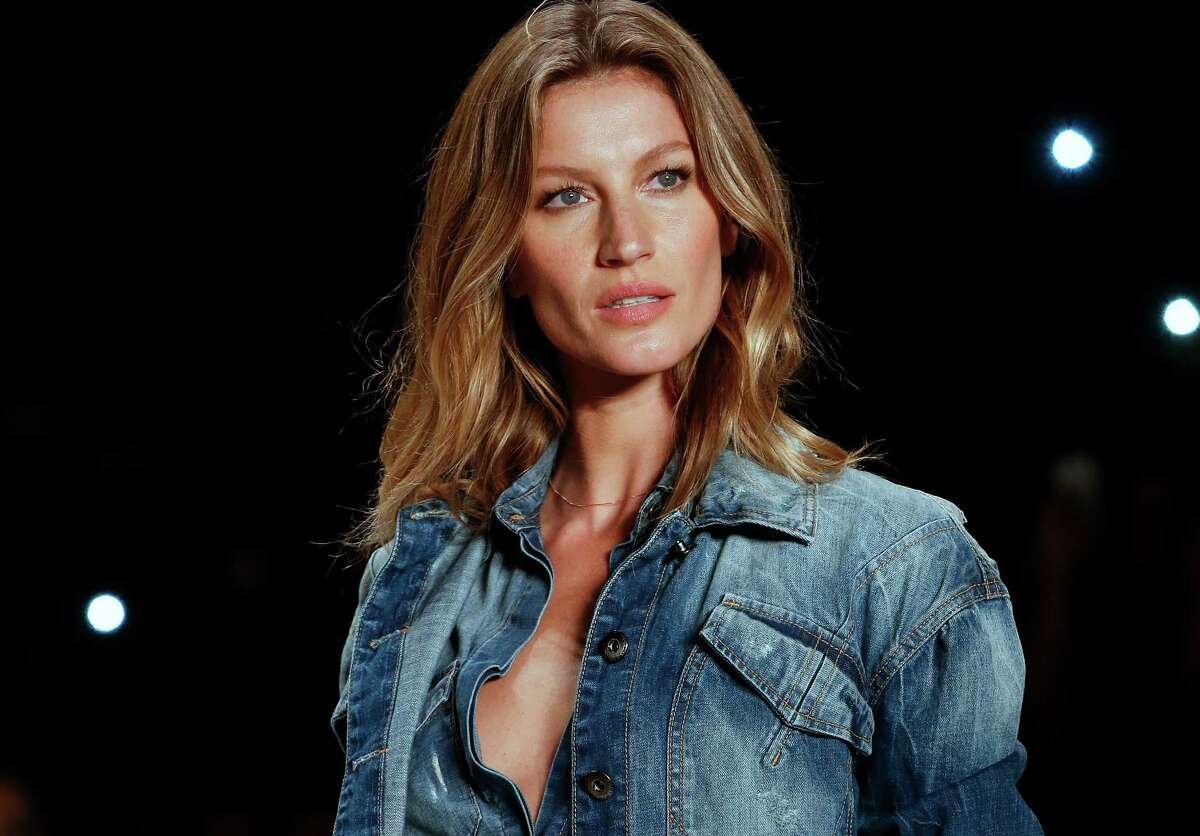 FILE - In this Nov. 4, 2014 file photo, Brazilian supermodel Gisele Bundchen wears a creation from the Colcci Winter collection at Sao Paulo Fashion Week in Sao Paulo, Brazil. Bundchen, who has been lighting up catwalks around the world for the past 20 years, is retiring from the runway. The 34-year-old mother-of-two has said her catwalk appearance on Wednesday, April 15, 2015 at Sao Paulo Fashion Week would be the last of her career. (AP Photo/Andre Penner, File) ORG XMIT: XLAT129