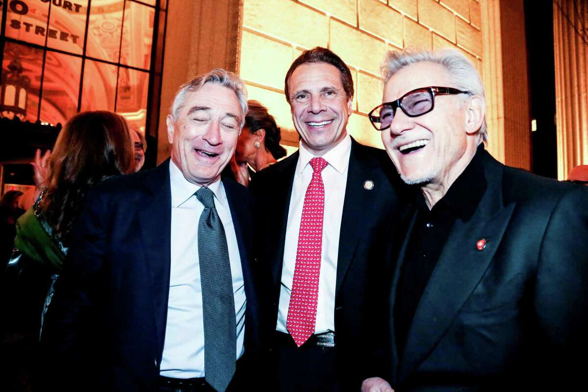 """From left: Robert De Niro with Gov. Andrew Cuomo and Harvey Keitel at Vanity Fair?'s party kicking off the Tribeca Film Festival, in New York, April 14, 2015. De Niro always looms large over Tribeca, particularly so this year, with ?""""Goodfellas?"""" closing the festival in celebration of its 25th anniversary. (Krista Schlueter/The New York Times) ORG XMIT: XNYT150"""