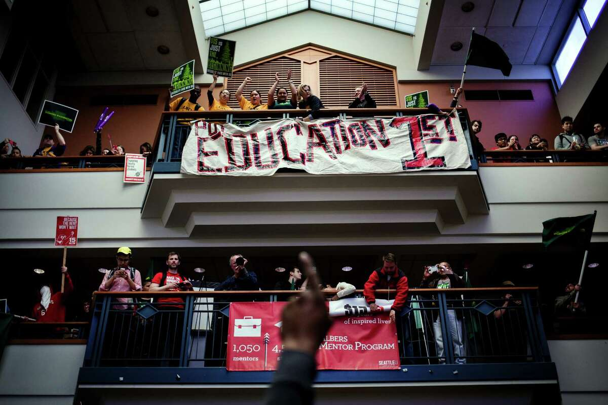Workers and students alike packed into Seattle University to rally together as part of the national mobilization in the movement against poverty-wage jobs, photographed Wednesday, April 15, 2015, in Seattle, Washington. Uber drivers, retail workers and adjunct professors joined fast food workers to march side by side in the peaceful protest, which concluded with 21 willing arrests by the Seattle Police Department.