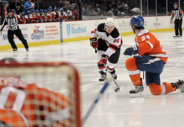 Albany Devils Reid Boucher takes a shot on goal during their hockey game against the Syracuse Crunch at the Times Union Center on Wednesday April 15, 2015 in Albany, N.Y. (Michael P. Farrell/Times Union) Photo: Michael P. Farrell / 00030124S