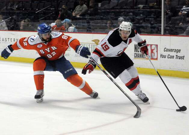 Albany Devils Mike Sislo brings the puck around during their hockey game against the Syracuse Crunch at the Times Union Center on Wednesday April 15, 2015 in Albany, N.Y. (Michael P. Farrell/Times Union) Photo: Michael P. Farrell / 00030124S