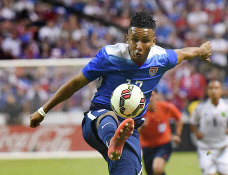 Juan Agudelo handles the ball during an international friendly match against Mexico at the Alamodome on Wednesday, April 15, 2015. Photo: Billy Calzada, San Antonio Express-News / San Antonio Express-News