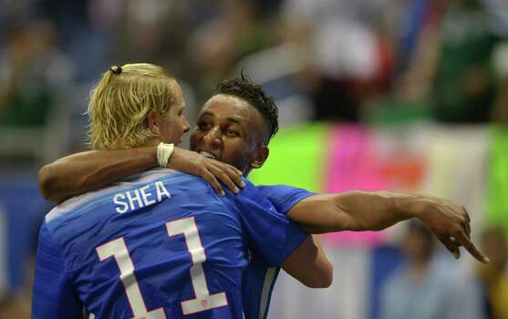 Brek Shea (11) and Juan Agudelo of the USA embrace in victory after defeating Mexico, 2-0, in an international friendly match at the Alamodome on Wednesday, April 15, 2015. Photo: Billy Calzada, San Antonio Express-News / San Antonio Express-News