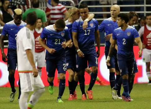 U.S. players congratulate teammate Juan Agudelo (17) after scoring the second goal against Mexico during the international friendly soccer match at the Alamodome on Wednesday, Apr. 15, 2015. The U.S. team defeated Mexico, 2-0. Photo: Kin Man Hui, San Antonio Express-News / ©2015 San Antonio Express-News